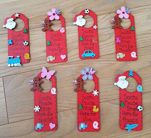 Personalised Santa door hangers wooden with little items on them