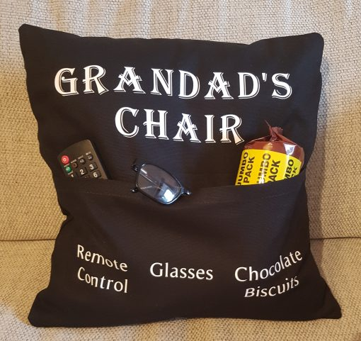 Black Pocket cushion case with Grandad's Chair on it along with object names on the pockets.