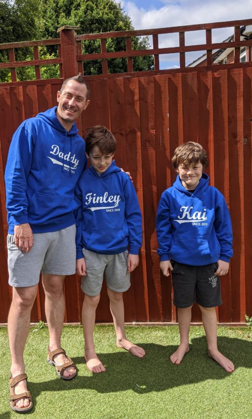 Personalised Family hoodies daddy and two sons wearing personalised hoodies.