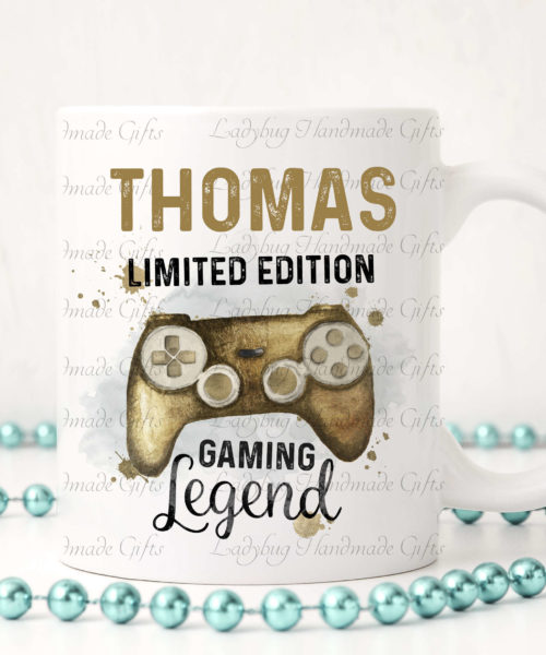 Personalised gaming mug with a gold games controller on.