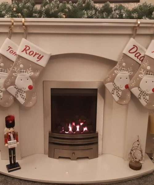 Grey Reindeer stockings hanging on fireside