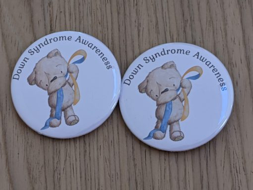 Badge with teddy holding ribbon for down syndrome awareness